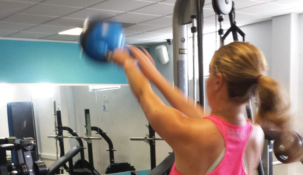 Lady working out with Kettle Bells